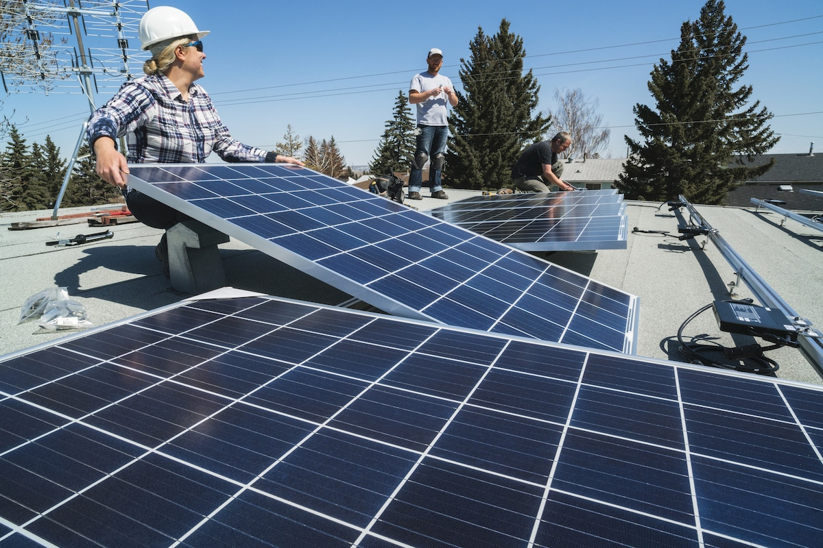 Hero program workers installing solar panels on a residential homes roof